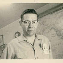 Bert Bullock shown in his office at 1134 Richards Street, circa 1955.