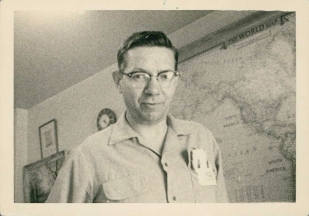 Bert Bullock shown in his office at 1134 Richards Street, circa 1955.